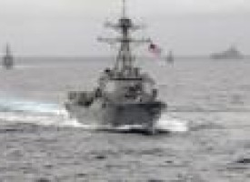 Angry China says shadowed U.S. warship near man-made islands in disputed sea